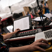 """June 21, 2014 - New York, NY : <br /> The city was flooded with music on Saturday as Make Music New York brought more than 1,300 free concerts to the city's streets and parks. The annual festival's program included the performance """"'In (Key)' - New Compositions in Celebration of Terry Riley's 'In C' @ 50 Years"""" on Cornelia Street, in front of the Cornelia Street Cafe in Greenwich Village, on Saturday afternoon. Pictured here, Patrick Grant, who helped produce the performance, during a break in music. <br /> CREDIT: Karsten Moran for The New York Times"""