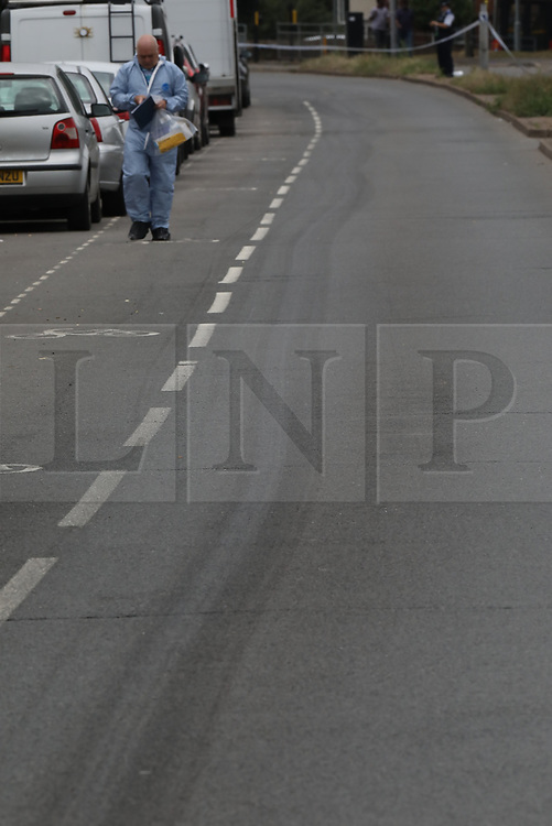 © Licensed to London News Pictures. 26/07/2019. Chessington, UK. Marks left by the victim's body are seen in Moor Lane in Chessington, south west London whera a man died after being hit by a car late last night. Police were called to a car in collision with a man on Moor Lane in Chessington at 00:13hrs on Friday, 26 July. The driver did not stop and the man was dragged under the car for some distance. Emergency services arrived an the man, believed to be aged 25 years, was pronounced dead on Moor Lane. Police believe they know the man's identity and his next of kin have been informed. Formal identification and a post-mortem examination will be arranged in due course. There has been no arrest. Enquiries are underway to establish the full circumstances. Photo credit: Peter Macdiarmid/LNP