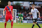 Dave Winfield & Luke James during the Capital One Cup match between York City and Bradford City at Bootham Crescent, York, England on 11 August 2015. Photo by Simon Davies.