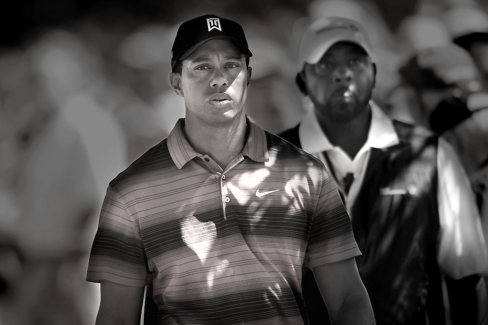 Photo By Michael R. Schmidt.Tiger Woods walks to the tee box at Cog Hill  underneath the shadows of a tree on September 12th 2010.