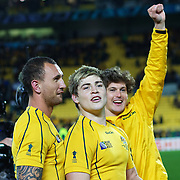 Quade Cooper, (left) James O'Connor, (centre), add Luke Burgess, Australia, celebrate after Australia's victory during the South Africa V Australia Quarter Final match at the IRB Rugby World Cup tournament. Wellington Regional Stadium, Wellington, New Zealand, 9th October 2011. Photo Tim Clayton...