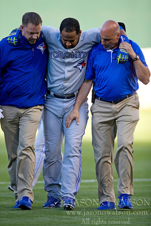 OAKLAND, CA - JULY 05:  Edwin Encarnacion #10 of the Toronto Blue Jays is assisted off the field by trainers after sustaining an injury during the first inning against the Oakland Athletics at O.co Coliseum on July 5, 2014 in Oakland, California. (Photo by Jason O. Watson/Getty Images) *** Local Caption *** Edwin Encarnacion