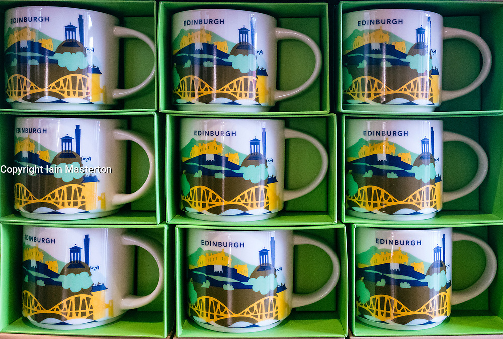 Starbucks mugs for sale in Edinburgh Cafe with themed city logos.