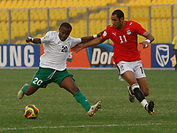 Photo: Steve Bond/Richard Lane Photography.<br />Egypt v Zambia. Africa Cup of Nations. 30/01/2008. , Felix Katongo (L) tries to hold off the incoming Mohamed Shawky (R)