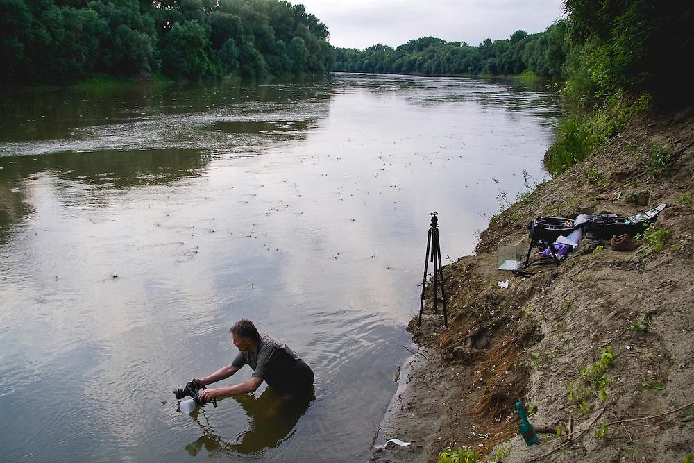 Behind the scene shot of the photographer, Milan Radisics on the location (lake Tisza), Hungary 2009