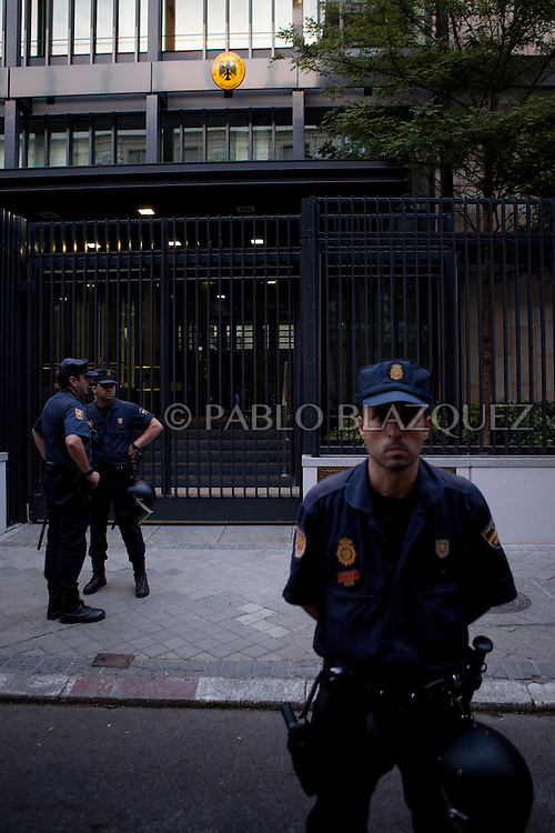 Riot police guards Gemany's Embasy during a demonstration against German Chancellor Angela Merkel's official visit to Spain, in central Madrid on September 6, 2012. Merkel is in Spain for talks with conservative Spanish President Mariano Rajoy.
