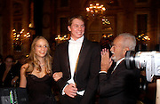 Carolyna de Laurentiis  with her escort Tommaso Trento while her  father Dino de Laurentiis looks on, The  Thirteenth Annual Crillon Haute Couture Ball. Paris,  29 November 2003. © Copyright Photograph by Dafydd Jones 66 Stockwell Park Rd. London SW9 0DA Tel 020 7733 0108 www.dafjones.com