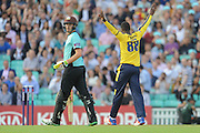 Hampshire T20 all-rounder Darren Sammy celebrates the wicket of Surrey Batsman Jason Roy during the NatWest T20 Blast South Group match between Surrey County Cricket Club and Hampshire County Cricket Club at the Kia Oval, Kennington, United Kingdom on 9 June 2016. Photo by David Vokes.