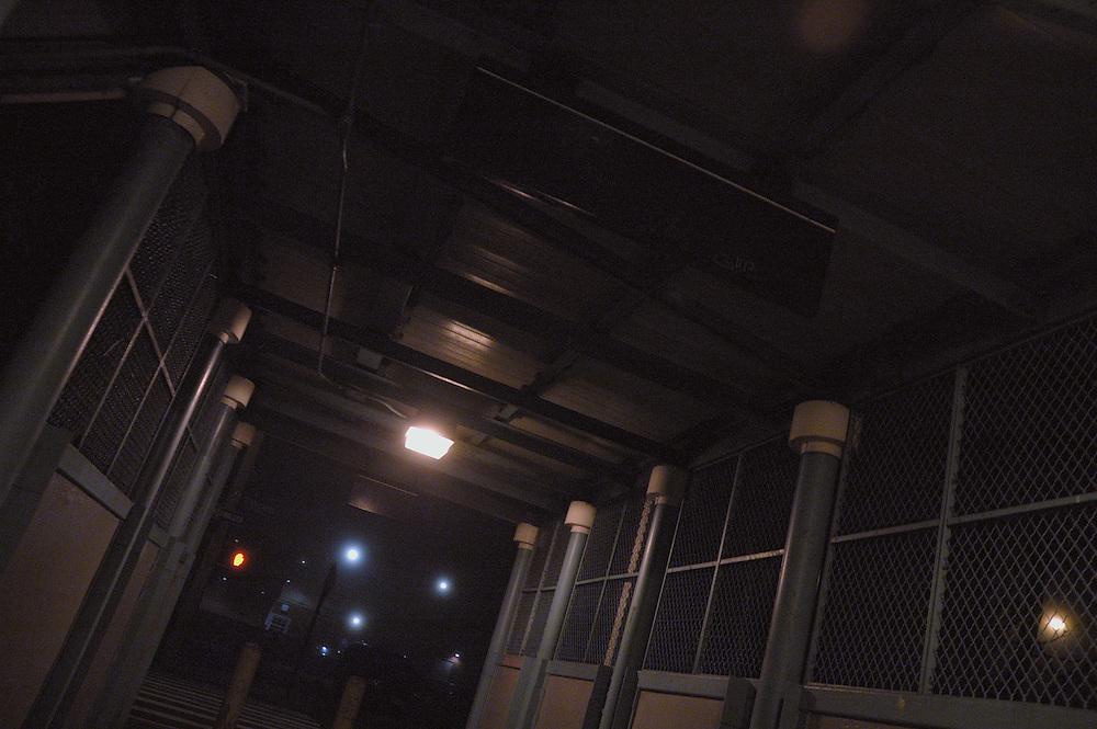 New York City Rapid Transit underpass corridor with three street lights in distance