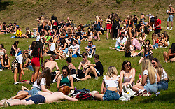 Glasgow, Scotland, UK. 25 June, 2020. Crowds of young people descended on Kelvigrove Park in the city's west end to enjoy the sunshine and hot temperatures of up to 28C.  Iain Masterton/Alamy Live News