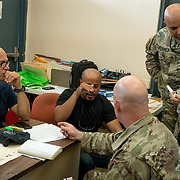 OCTOBER 20 - SANTA ISABEL, PUERTO RICO - <br /> Santa Isabel mayor Enrique Questell Alvarado, left,  and 105th Engineer Battalion Lt. Coronel Cale Moody, go over maps showing areas the town needs help from the US Military in. Municipal employee Ricky Burgos, middle, is translating.<br /> (Photo by Angel Valentin/Freelance)