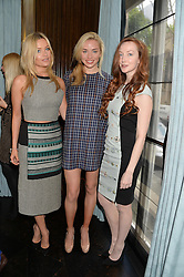 Left to right, LAURA WHITMORE, NOELLE RENO and OLIVIA GRANT at the 'Ladies of Influence Lunch' held at Marcus, The Berkeley Hotel, London on 12th May 2014.