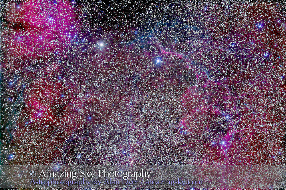 The Vela Supernova Remnant in the centre of the Gum Nebula area of Vela. This is the remains of a star that exploded thousands of years ago.<br /> <br /> The emission nebula at upper left is Gum 17, at centre left is Gum 18.<br /> <br /> This is a stack of 10 x 12 minute exposures with the Borg 77mm astrographic apo refractor at f/4.3 (330mm focal length) and the filter-modified Canon 5D Mark II at ISO 800. The image has been highly processed in contrast to bring out the faint nebulosity and arcs of the remnant. Taken from Coonabarabran, Australia March 2014.