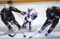 Ales Music (16) of SLovenia between Timothy Gleason (6) and Lee Stempniak (12) at ice-hockey match USA vs Slovenia at Preliminary Round (group B) of IIHF WC 2008 in Halifax, on May 04, 2008 in Metro Center, Halifax, Nova Scotia, Canada. (Photo by Vid Ponikvar / Sportal Images)