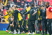 Watford FC hold hands and run together in celebration following the FA Cup semi-final match between Watford and Wolverhampton Wanderers at Wembley Stadium in London, England on 7 April 2019.