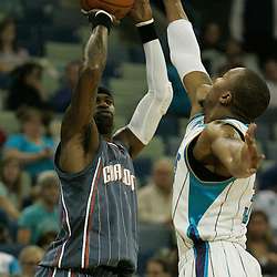 Apr 07, 2010; New Orleans, LA, USA; Charlotte Bobcats guard Stephen Jackson (1) shoots over New Orleans Hornets forward David West (30) during the first half at the New Orleans Arena. Mandatory Credit: Derick E. Hingle-US PRESSWIRE