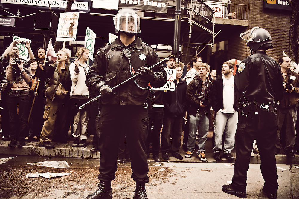 Police officers in riot gear keep  peace at Iraq war protest in San Francisco, CA.  Copyright 2008 Reid McNally.