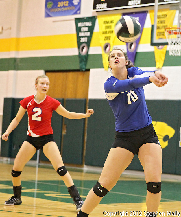 Washington's Danielle Franklin (10) goes for a dig as Alisa Gerhold (2) looks on during the MVC Volleyball Tournament Championship game between the Hempstead Mustangs and the Washington Warriors at Kennedy High School in Cedar Rapids on Saturday October 13, 2012. Hempstead defeated Washington 25-21 25-19.
