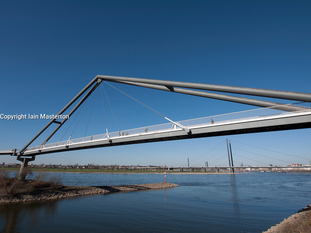 Modern footbridge crossing river Rhine at Media harbour in Dusseldorf Germany
