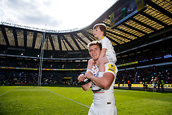 Saracens Fly-Half Owen Farrell celebrates with his younger brother after Saracens win the Aviva Premiership - Photo mandatory by-line: Rogan Thomson/JMP - 07966 386802 - 30/05/2015 - SPORT - RUGBY UNION - London, England - Twickenham Stadium - Bath Rugby v Saracens - 2015 Aviva Premiership Final.