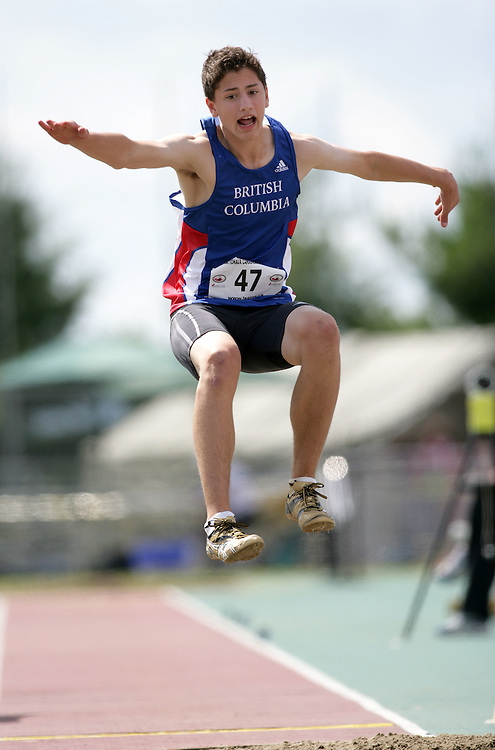 (Sherbrooke, Quebec -- 20090808)  Ben Daly-Grafstein of  British Columbia competes in Boys under-15 long jump final at the 2009 Royal Canadian Legion National Youth track and field championships. Photograph copyright Sean Burges / Mundo Sport Images  2009.