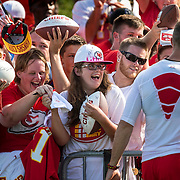 Mica Stiffler of Wichita reacted after receiving a hug from Kansas City Chiefs quarterback Alex Smith, right, following the team's training camp practice Saturday afternoon at Missouri Western State University in St. Joseph, Mo.