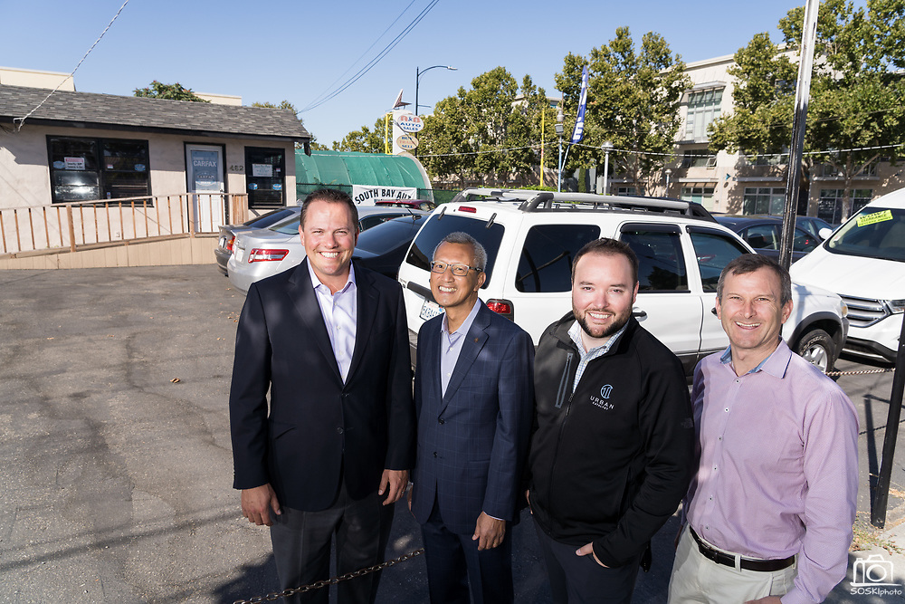 Urban Catalyst poses for a group photo at a future build site in San Jose, California, on September 3, 2019. (Stan Olszewski/SOSKIphoto)