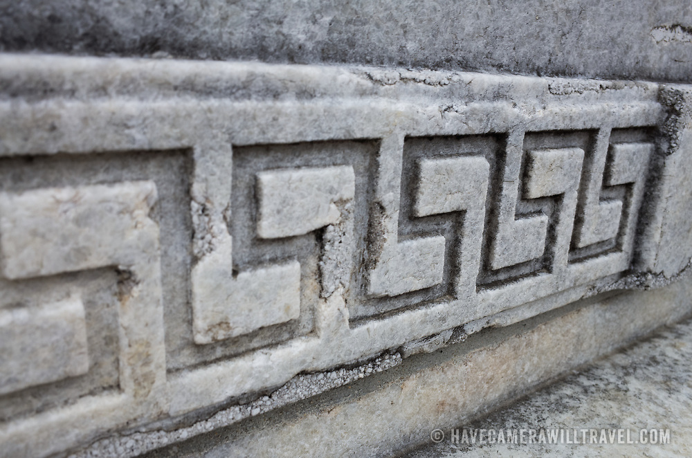 A geometric pattern carved into the base of the Cuban Friendship Urn in Washington DC. Located in East Potomac Park in Washington DC, the Cuban American Friendship Urn is a 7-ton white marble urn carved from one of the columns that was originally part of the Maine Monument in Havana, Cuba, that memorialized the sinking of the Maine, an event that helped spark the Spanish American War and led to the independence of Cuba from Spain.