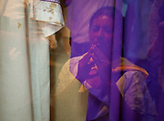 A pilgrim visiting the rectory home of martyred Archbishop Oscar Romero is reflected in a glass door as she drops to her knees, and begins praying while viewing the bloodstained vestments of the priest. El Salvador prepares for the beatification ceremony and mass announcing the beatification of Archbishop Oscar Romero. The Archbishop was slain at the alter of his Church of the Divine Providence by a right wing gunman in 1980. Oscar Arnulfo Romero y Galdamez became the fourth Archbishop of San Salvador, succeeding Luis Chavez, and spoke out against poverty, social injustice, assassinations and torture. Romero was assassinated while offering Mass on March 24, 1980.