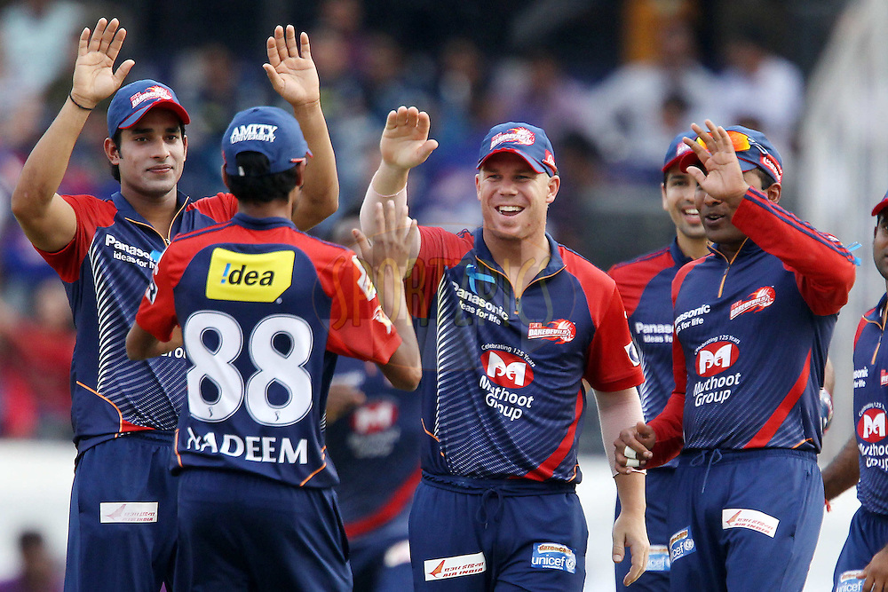 David Warner and the Delhi Dardevils celebrate the wicket of Kumar Sangakkara during match 55 of the the Indian Premier League ( IPL) 2012  between The Deccan Chargers and the Delhi Daredevils held at the Rajiv Gandhi Cricket Stadium, Hyderabad on the 10th May 2012..Photo by Ron Gaunt/IPL/SPORTZPICS