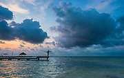 A McCallen TX angler gets an early start on the day casting to cruising bonefish amidst gathering storm clouds.