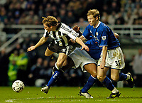 Photo. Jed Wee.<br /> Newcastle United v Leicester City, FA Barclaycard Premiership, St James' Park, Newcastle. 07/02/2004.<br /> Newcastle's Craig Bellamy (L) is sent flying on his return to action by a Leicester double team.
