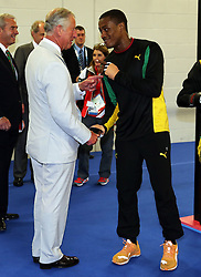 Image licensed to i-Images Picture Agency. 23/07/2014. Glasgow, United Kingdom. Prince of Wales talks to Jamaican boxer  Cheavon Clarke during a visit  to the Commonwealth Games in Glasgow  Picture by Stephen Lock / i-Images