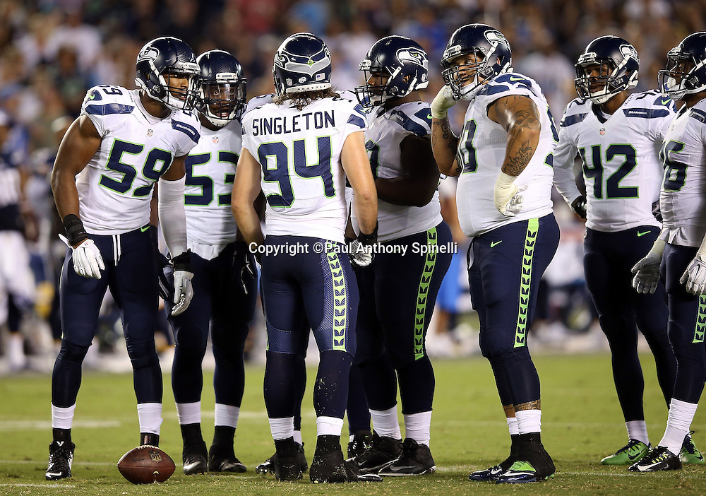 Seattle Seahawks linebacker Alex Singleton (94) addresses the defense during the 2015 NFL preseason football game against the San Diego Chargers on Saturday, Aug. 29, 2015 in San Diego. The Seahawks won the game 16-15. (©Paul Anthony Spinelli)