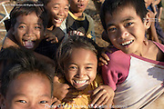 A group of happy and playful children enjoy their afternoon in Ban Lung, Cambodia. The group of youngsters are the children of rural subsistance farmers.