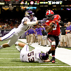 December 22, 2012; New Orleans, LA, USA; Louisiana-Lafayette Ragin Cajuns wide receiver Harry Peoples (9) runs past East Carolina Pirates linebacker Jeremy Grove (53) and defensive back Damon Magazu (11) for a touchdown during the second quarter of the New Orleans Bowl at the Mercedes-Benz Superdome. Mandatory Credit: Derick E. Hingle-USA TODAY Sports