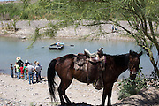 Boys from the village of Boquillas del Carmen, left, wait to sell souvenirs to tourists making the river crossing from Big Bend National Park on May 15, 2014.