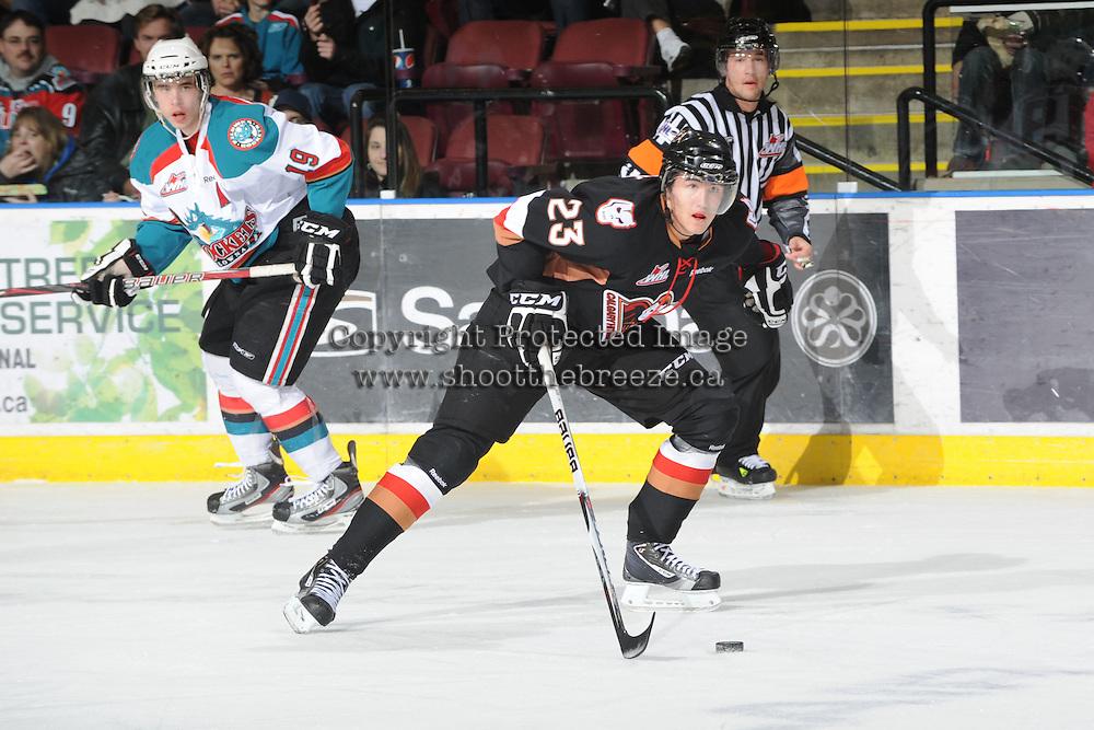 KELOWNA, CANADA, FEBRUARY 17: Victor Rask #23 of the Calgary Hitmen skates with the puck at the Kelowna Rockets on February 17, 2012 at Prospera Place in Kelowna, British Columbia, Canada (Photo by Marissa Baecker/Shoot the Breeze) *** Local Caption ***