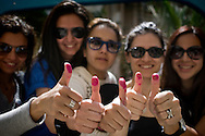 EGYPT, Cairo : Egyptian women show their ink-stained thumbs after voting in Cairo on March 19, 2011. Egyptians got their first taste of democracy in a referendum to a package of constitutional changes after president Hosni Mubarak was forced to relinquish his 30-year grip on power last month in the face of mass street protests. ALESSIO ROMENZI