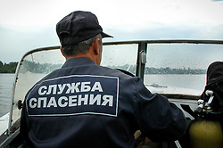 May 27, 2019 - Tambov, Tambov region, Russia - A member of the rescue service of EMERCOM of Russia is patrolling the river Tsna on the boat  (Credit Image: © Demian Stringer/ZUMA Wire)