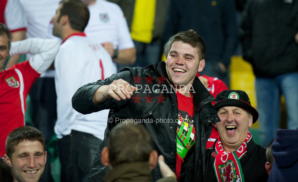 SOFIA, BULGARIA - Tuesday, October 11, 2011: Wales supporter Chris Davies, 25 from Corwen, Wales, with Craig Bellamy's match shirt after the Welsh star threw it into the away fans section following a 1-0 victory over Bulgaria during the UEFA Euro 2012 Qualifying Group G match at the Vasil Levski National Stadium. (Pic by David Rawcliffe/Propaganda)