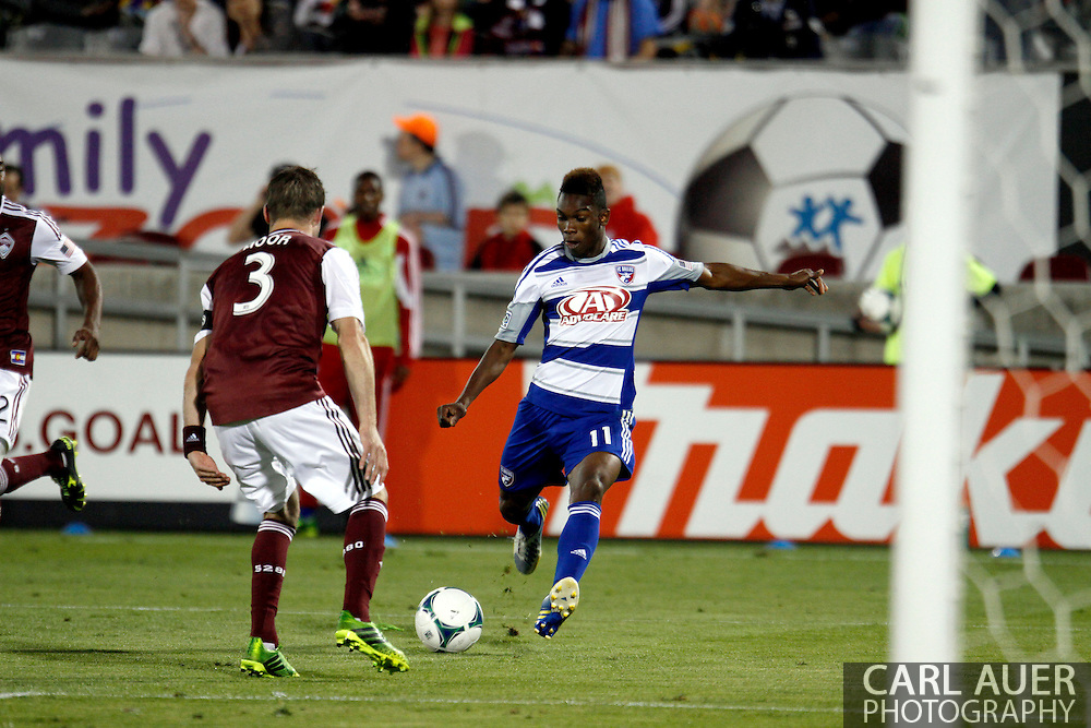June 1st, 2013 - FC Dallas forward Fabian Castillo (11) attempts to get a shot past the defense by the Colorado Rapids Drew Moor (3) in second half action of the MLS match between FC Dallas and the Colorado Rapids at Dick's Sporting Goods Park in Commerce City, CO