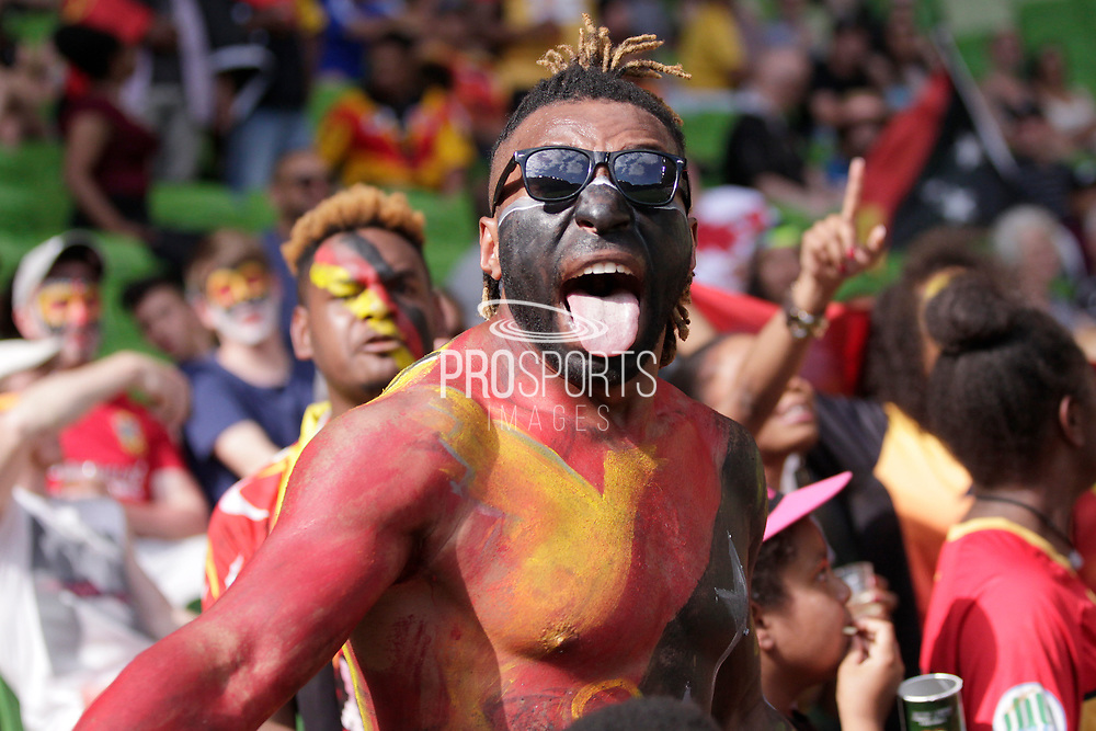 A PNG fan celebrates after a try to PNG during the Rugby League World Cup Quarter-Final match between England and  Papua New Guinea at Melbourne Rectangular Stadium, Melbourne, Australia on 19 November 2017. Photo by Mark  Witte.