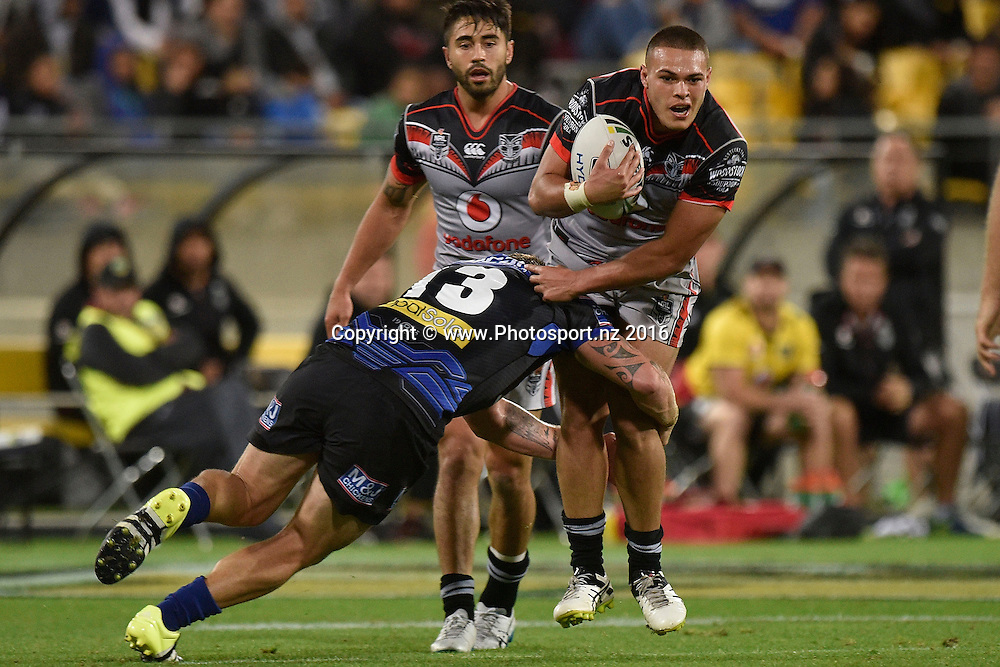 Warriors' Tuimoala Lolohea is tackled by Bulldogs' Greg Eastwood during the NRL Warriors vs Bulldogs Rugby League match at the Westpac Stadium in Wellington on Saturday the 16th of April 2016. Copyright Photo by Marty Melville / www.Photosport.nz