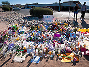 "15 JANUARY 2010 - TUCSON, AZ:    A memorial for Congresswoman GABRIELLE GIFFORDS and others shot Sat. Jan. 8 at the intersection of Ina and Oracle Roads in Tucson, AZ, Saturday, January 15. Six people were killed and 14 injured in the shooting spree at a ""Congress on Your Corner"" event hosted by Arizona Congresswoman Gabrielle Giffords at a Safeway grocery store in north Tucson on January 8. Congresswoman Giffords, the intended target of the attack, was shot in the head and seriously injured in the attack but is recovering. Doctors announced that they removed her breathing tube Saturday, one week after the attack. The alleged gunman, Jared Lee Loughner, was wrestled to the ground by bystanders when he stopped shooting to reload the Glock 19 semi-automatic pistol. Loughner is currently in federal custody at a medium security prison near Phoenix.  PHOTO BY JACK KURTZ"