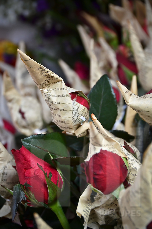 Roses wrapped in newspaper at the market in Sapa city, Lao Cai province, North Vietnam.