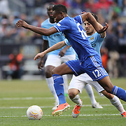 John Obi Mikel, Chelsea, is challenged by David Silva, Manchester City, in action during the Manchester City V Chelsea friendly exhibition match at Yankee Stadium, The Bronx, New York. Manchester City won the match 5-3. New York. USA. 25th May 2012. Photo Tim Clayton
