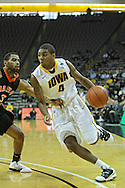 December 04 2010: Iowa Hawkeyes guard/forward Roy Devyn Marble (4) drives with the ball against Idaho State Bengals guard Phyllip Taylor (3) during the second half of their NCAA basketball game at Carver-Hawkeye Arena in Iowa City, Iowa on December 4, 2010. Iowa won 70-53.