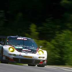 July 6, 2012 - The Paul Miller Racing Porsche 911 GT3 RSR driven by Bryce Miller and Sascha Maassen during the American Le Mans Northeast Grand Prix weekend at Lime Rock Park in Lakeville, Conn.