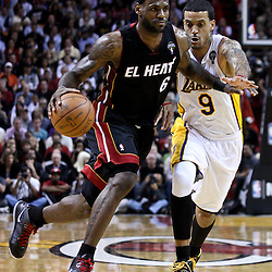 March 10, 2011; Miami, FL, USA; Miami Heat small forward LeBron James (6) drives past Los Angeles Lakers small forward Matt Barnes (9) during the fourth quarter at the American Airlines Arena. The Heat defeated the Lakers 94-88.   Mandatory Credit: Derick E. Hingle